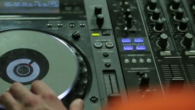 Dj Working At The Console
