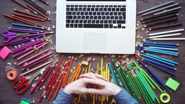 Workplace With Colored Pencils, Laptop, Palette On Wooden Table