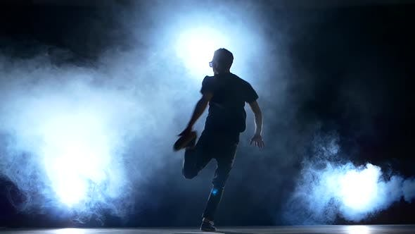 Thumbnail for Young Hiphop Dancer Starts Making a Move, Smoke, Silhouette, Slow Motion