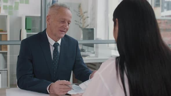 Thumbnail for Senior Businessman Talking to Job Candidate