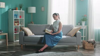 Young Woman Is Captivated By Reading