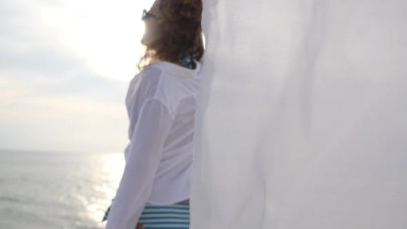 Thumbnail for Sensual Girl In White Shirt On Beach By The Sea