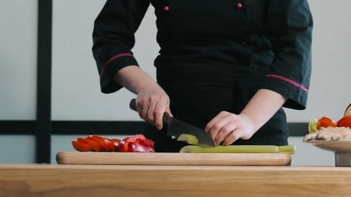Professional Chef Chopping Celery