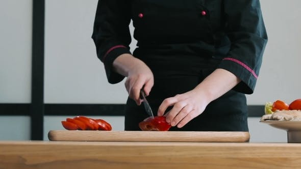 Thumbnail for Cook Cutting Pepper On a Cutting Board