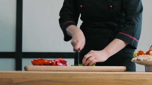 Thumbnail for Chef Chopped Green Onions On a Cutting Board