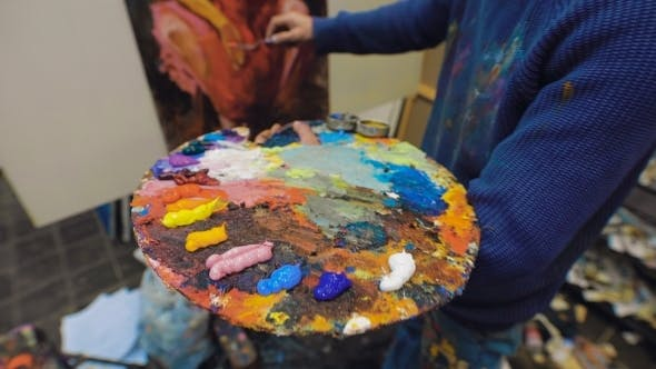 Thumbnail for Artist Paints a Picture Of Oil Paint Brush In Hand With Palette