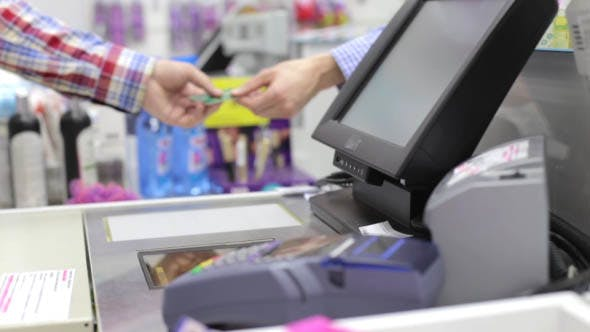 Thumbnail for Man  is Shopping, Paying by Credit Card