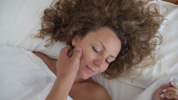 Thumbnail for Loving Man Hand Waking Up Beautiful Young Woman