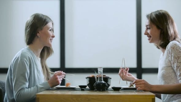 Cover Image for Girlfriends Talking In a Japanese Restaurant