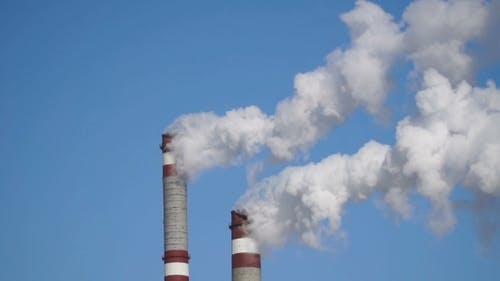 Industrial Chimneys Emits Toxic Pollutants Into The Sky Polluting The Environment