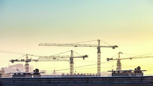 Thumbnail for Sunset And Silhouette Crane Working In Construction Site