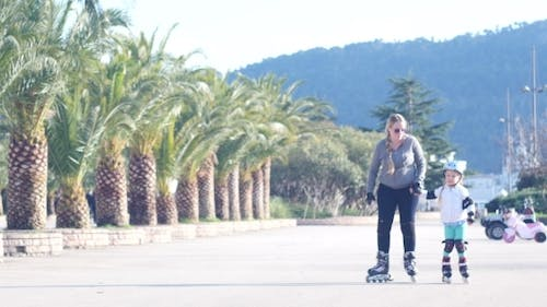 Child Rollerblading Outdoors. Sport Lifestyle.