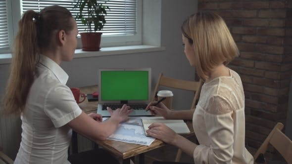 Cover Image for Business Meeting. The Woman Presenting Report On The Paper And Laptop.