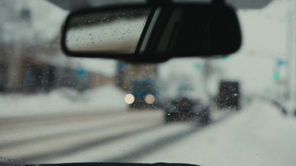 Thumbnail for Cars Driving On a Snowy Road. The Reflection In The Rearview Mirror