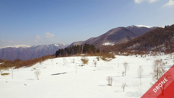Thumbnail for Aerial View of Snowy Mountains in a Sunny Day