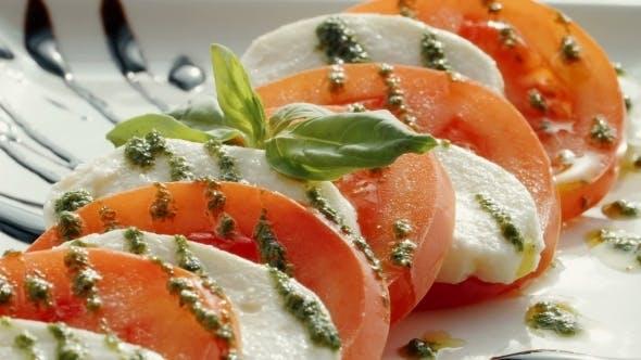 Thumbnail for Cooking Salad Of Mozzarella, Tomato, Greens.