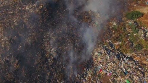 Huge Burning Waste Deposit Covered With Smoke