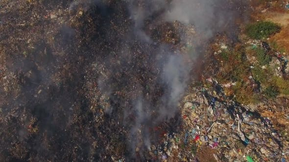 Thumbnail for Huge Burning Waste Deposit Covered With Smoke