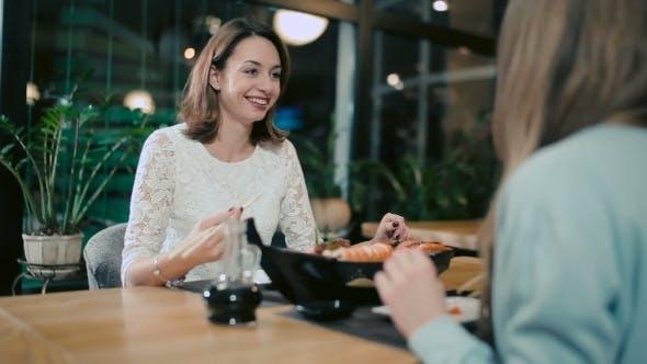 Cover Image for Girlfriends Eating Sushi In Japanese Restaurant.