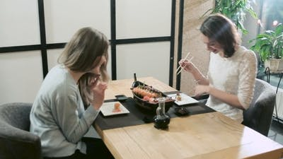 Girls Whispering Confering Privately In Restaurant