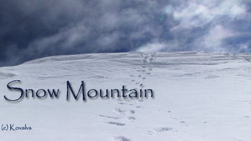 Snowy Mountainside With Footprints