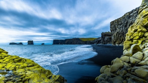 Cover Image for . Waves Breaking On The Black Sand Beach On a Background Of Mountain Lava. Reynisdrangar Beach