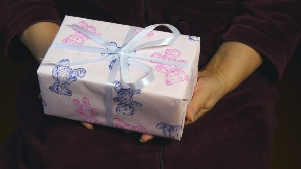 Thumbnail for Female Hands Giving a Gift To Boy.