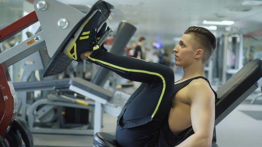 Athlete Using Leg Press Machine