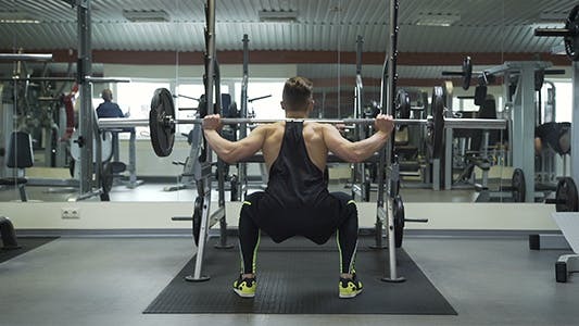 Thumbnail for Athlete Performs Wide Stance Barbell Squats 2