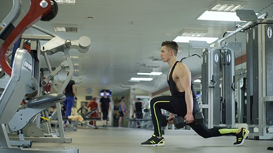 Thumbnail for Athlete Performs Lunge With Weights