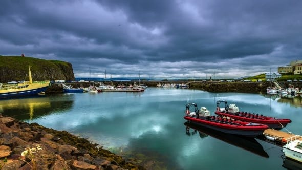 Cover Image for The Water In The Port Reflects Floating Clouds in Iceland