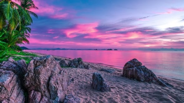 Cover Image for Incredible Violet Sunset Over The Sea And Rocky Beach, Koh Samui, Thailand