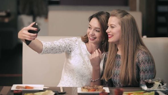 Thumbnail for Two Pretty Girls Posing For a Selfie