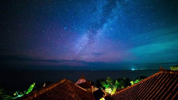 Cover Image for The Milky Way Above The Roofs Of Bungalows And Indian Ocean. 15 July 2015, Bali, Indonesia