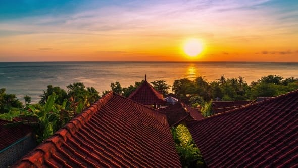 Cover Image for Sunrise Overlooking The Roofs Of The Bungalows And The Indian Ocean