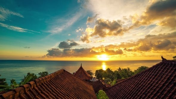 Cover Image for Sunrise Overlooking The Roofs Of The Bungalows And The Ocean in Bali