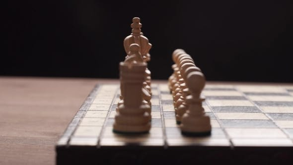 Thumbnail for Man Playing Wooden Chess Pieces