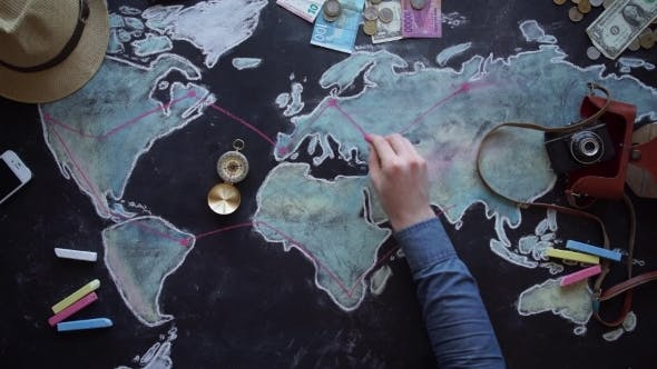 Thumbnail for Young Couple Planning Honeymoon Vacation Trip With Map