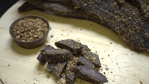 Biltong South African Beef Jerky On a Cutting Board