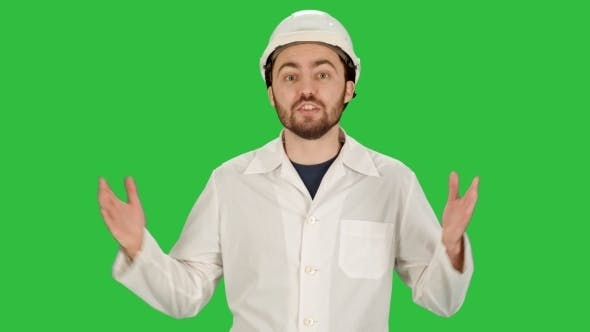 Thumbnail for Smiling Male Architect With Talking On Camera On a Green Screen, Chroma Key.