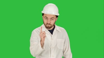Man In The Construction Helmet With a Raised Finger