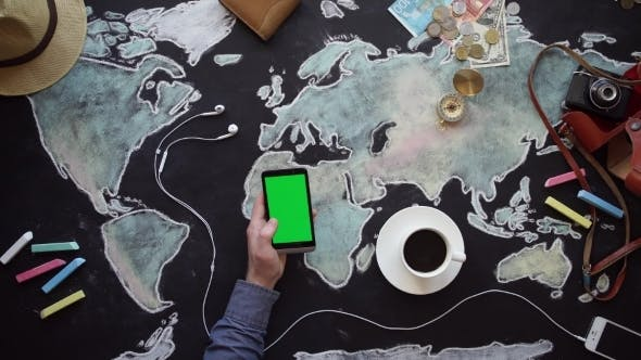 Thumbnail for Hand, Map, Compass, Money And Phone On The Chalkboard Table.