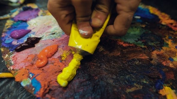 Thumbnail for An Artist Squeezes Out Some Yellow Paint From a Tube Of Oil Paint.