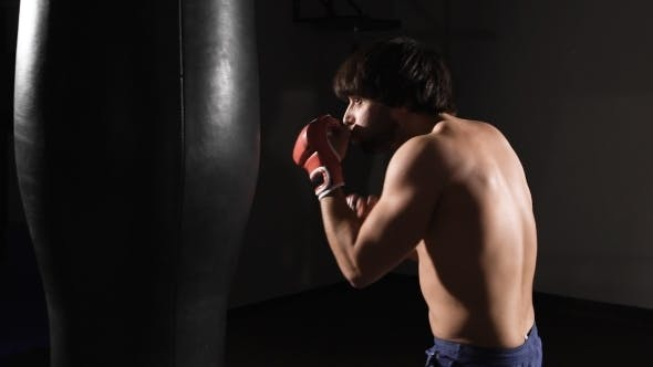 Thumbnail for Concentration. Young Muscular Athlete Fulfills Kick.