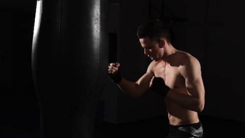 The Growth Of Strength And Agility. Young Muscular Athlete Fulfills Blows. Boxing.