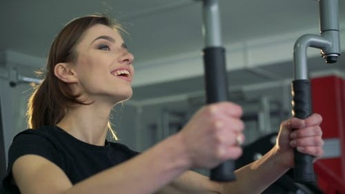 The Girl At The Gym On a Simulator