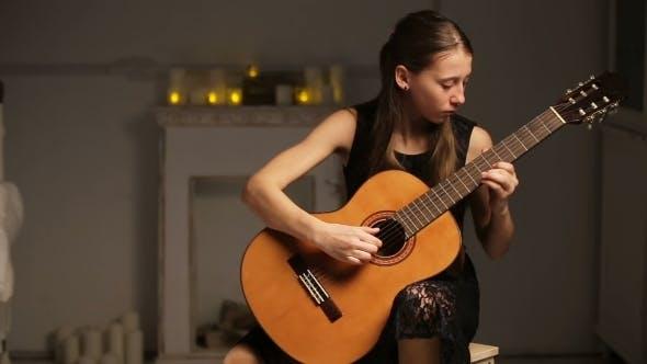 Thumbnail for Girl Playing The Guitar