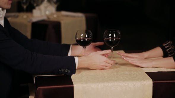 Thumbnail for Couple Holding Their Hands In a Restaurant