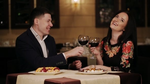 Thumbnail for Smiling Couple Clinking Glasses Of Wine During Lunch At The Restaurant