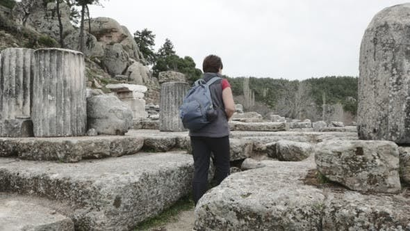 Thumbnail for Woman Takes a Picture Among Ruins
